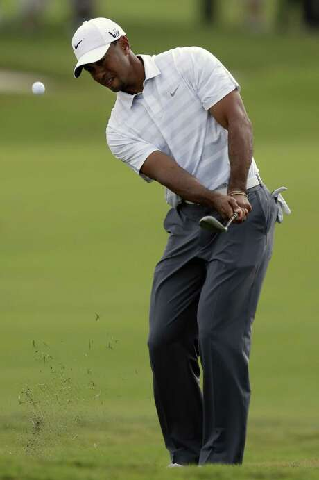 Tiger Woods, who leads the Cadillac Championship by four shots, hits from the fifth fairway during the third round on the Blue Monster in Doral, Fla. Photo: Wilfredo Lee / Associated Press