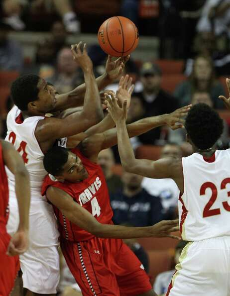 Travis' Daniel Chika (4) battles with others including South Grand Prairie's Rick Curry (24) for a r