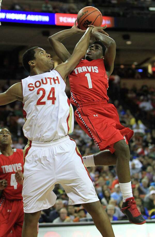 Travis' John Burnett (1) jumps up for the basket against South Grand Prairie'd Rick Curry (24) during the first half of the UIL 5A boys state basketball championship game between Fort Bend Travis and South Grand Prairie at the Frank Erwin Center, Saturday, March 9, 2013, in Austin. Photo: Karen Warren, Houston Chronicle / © 2013 Houston Chronicle