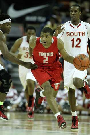 Travis' Aaron Harrison (2) runs up the court during the first half of the UIL 5A boys state basketball championship game between Fort Bend Travis and South Grand Prairie at the Frank Erwin Center, Saturday, March 9, 2013, in Austin. Photo: Karen Warren, Houston Chronicle / © 2013 Houston Chronicle
