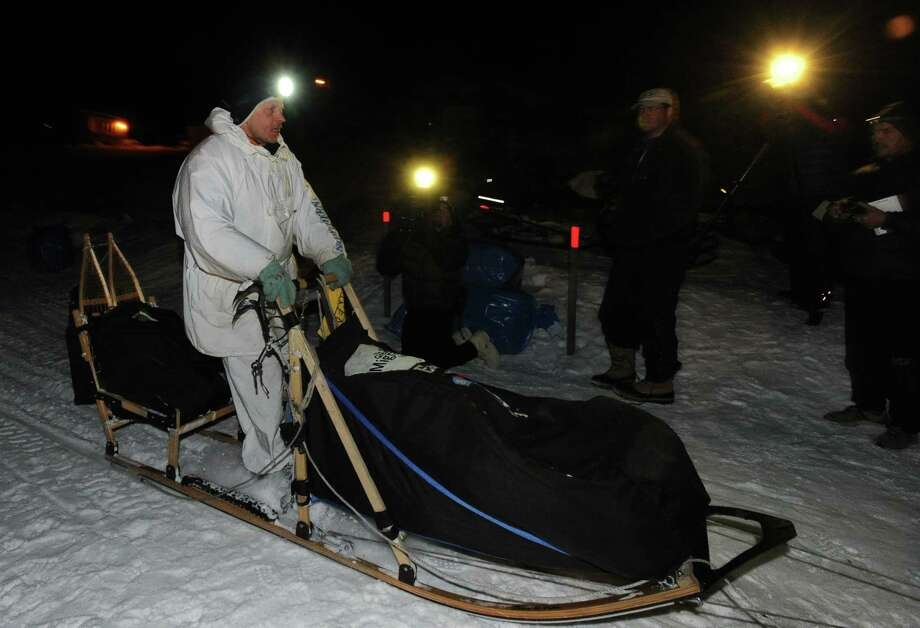Four-time Iditarod champion Martin Buser is first to arrive early Friday at the Yukon River in Anvik, Alaska, during the Iditarod Trail Sled Dog Race. Photo: Bill Roth, MBO / Anchorage Daily News