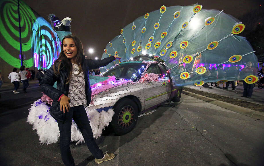 Katie Peacock spots an art car with her namesake and has her parents take a picture of her with it as Luminaria is held in downtown San Antonio on March 9, 2013. Photo: TOM REEL, San Antonio Express-News / San Antonio Express-News