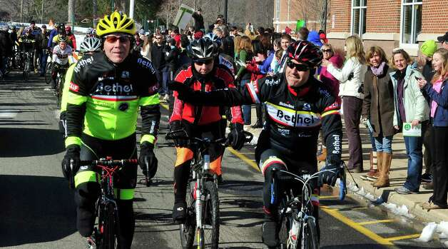 Team 26 and supporting riders, including Jay Moody, left, leave Reed Intermediate School in Newtown, Conn. Saturday, March 9, 2013 on the Sandy Hook Ride to Washington, D.C., to support gun control legislation. Photo: Michael Duffy / The News-Times