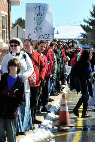 Well wishers watch Team 26 and supporting riders leave Reed Intermediate School in Newtown, Conn. Saturday, March 9, 2013 on the Sandy Hook Ride to Washington, D.C., to support gun control legislation. Photo: Michael Duffy / The News-Times