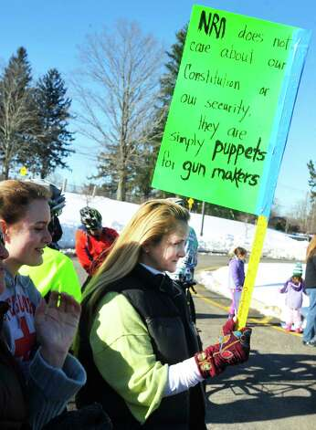 Well wishers, including Dr. Andrea Moore, center, watch Team 26 and supporting riders leave Reed Intermediate School in Newtown, Conn. Saturday, March 9, 2013 on the Sandy Hook Ride to Washington, D.C., to support gun control legislation. Photo: Michael Duffy / The News-Times