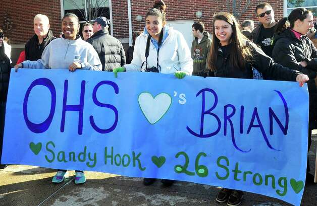 Well wishers, including some from Oxford High School, watch Team 26 and supporting riders leave Reed Intermediate School in Newtown, Conn. Saturday, March 9, 2013 on the Sandy Hook Ride to Washington, D.C., to support gun control legislation. Photo: Michael Duffy / The News-Times
