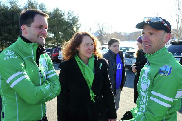 Jim Himes, D-4th, left, Elizabeth Esty, D-5th, and Monte Frank, who organized the Team 26 Sandy Hook Ride to Washington, D.C., to support gun control legislation talk while preparing to leave Reed Intermediate School in Newtown, Conn. Saturday, March 9, 2013 Photo: Michael Duffy / The News-Times