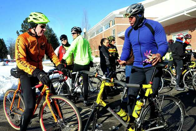 Mark Lurie, of Newtown, left, and Dwayne Perkins, City Council member, talk while preparing to leave Reed Intermediate School in Newtown, Conn. Saturday, March 9, 2013 on the Team 26 Sandy Hook Ride to Washington, D.C., to support gun control legislation. Photo: Michael Duffy / The News-Times