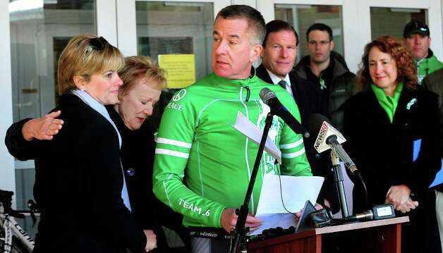 Newtown First Selectman Patricia Llodra, left center, comforts Lynn Mc Donnell, left, as Chris Mc Donnell speaks before Team 26 and supporting riders leave Reed Intermediate School in Newtown, Conn. Saturday, March 9, 2013 on the Sandy Hook Ride to Washington, D.C., to support gun control legislation. The Mc Donnell's lost their daughter Grace in the Sandy Hook shootings. Photo: Michael Duffy / The News-Times
