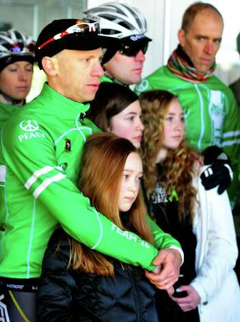 Monte Frank, who organized the Team 26 Sandy Hook Ride to Washington, D.C., to support gun control legislation, stands with arms around his daughter, Sarah Frank, 11, while preparing to leave Reed Intermediate School in Newtown, Conn. Saturday, March 9, 2013 Photo: Michael Duffy / The News-Times