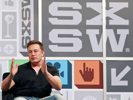 Elon Musk, SpaceX CEO and Chief Designer, CEO and Product Architect of Tesla Motors, co-founder of PayPal, and non-executive chairman and principal shareholder of SolarCity, speaks at the Austin Convention Center during South by Southwest Saturday March 9, 2013 in Austin, TX. Photo: Edward A. Ornelas, San Antonio Express-News / © 2013 San Antonio Express-News