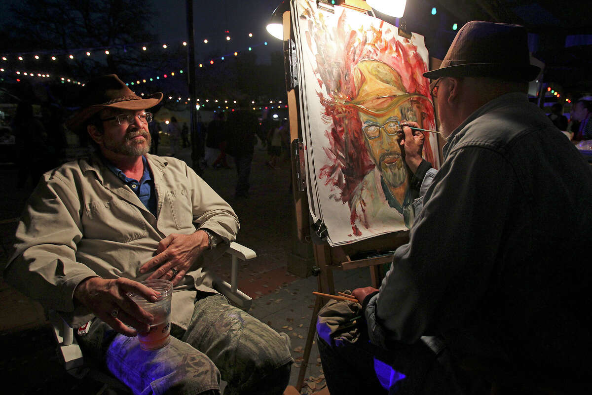 Bob Bevard has his portrait painted by artist J.D. Morera as Luminaria is held in downtown San Antonio on March 9, 2013.