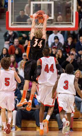 Ridgefield high school's Kurt Steidl dunks the ball in a quarterfinal round 2013 CIAC class LL boys basketball tournament game against Fairfield Prep held at Alumni Hall, Fairfield University, Fairfield CT on Saturday March 9th 2013. Photo: Mark Conrad / Connecticut Post Freelance