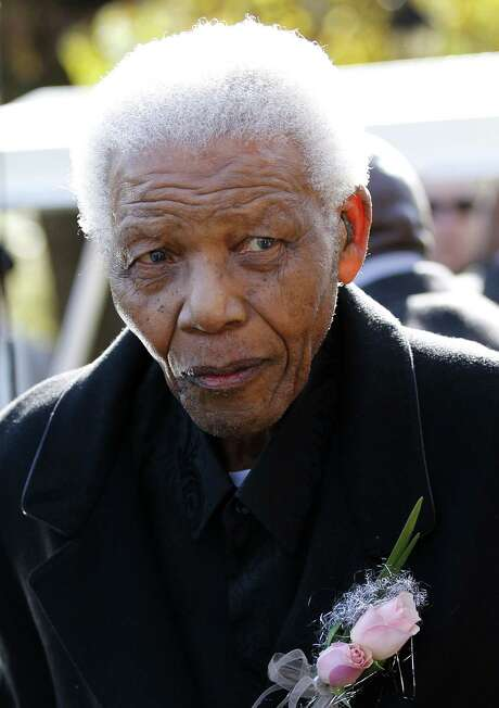"""This file picture taken on June 17, 2010 shows former South African President Nelson Mandela arriving for the funeral of his great-granddaughter Zenani Mandela at St Stithian‰??s College Chapel in Sandton, north of Johannesburg. Nelson Mandela was hospitalised on March 9, 2013 for a """"scheduled medical check-up"""", the presidency said, months after he underwent treatment for lung infection and gallstones. AFP PHOTO/ POOL/Siphiwe SibekoSIPHIWE SIBEKO/AFP/Getty Images Photo: SIPHIWE SIBEKO, Staff / AFP"""