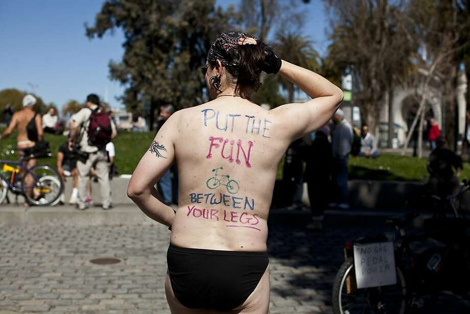 "Damian Mason had the words ""put the fun between your legs"" painted on his back during the World Naked Bike Ride at Justin Herman Plaza in San Francisco, Calif., Saturday, March 9, 2013. Photo: Jason Henry, Special To The Chronicle"
