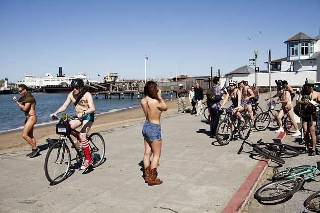 Nude and partially nude cyclists stopped to take photos at the Maritime Historical Park for the World Naked Bike Ride in San Francisco, Calif., Saturday, March 9, 2013. Photo: Jason Henry, Special To The Chronicle