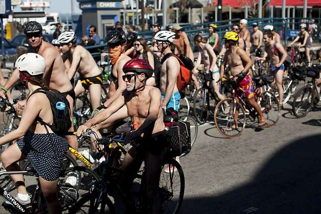 Nude cyclists rode down Fisherman's Wharf, eliciting hoots and hollers from bystanders, during the World Naked Bike Ride in San Francisco, Calif., Saturday, March 9, 2013. Photo: Jason Henry, Special To The Chronicle
