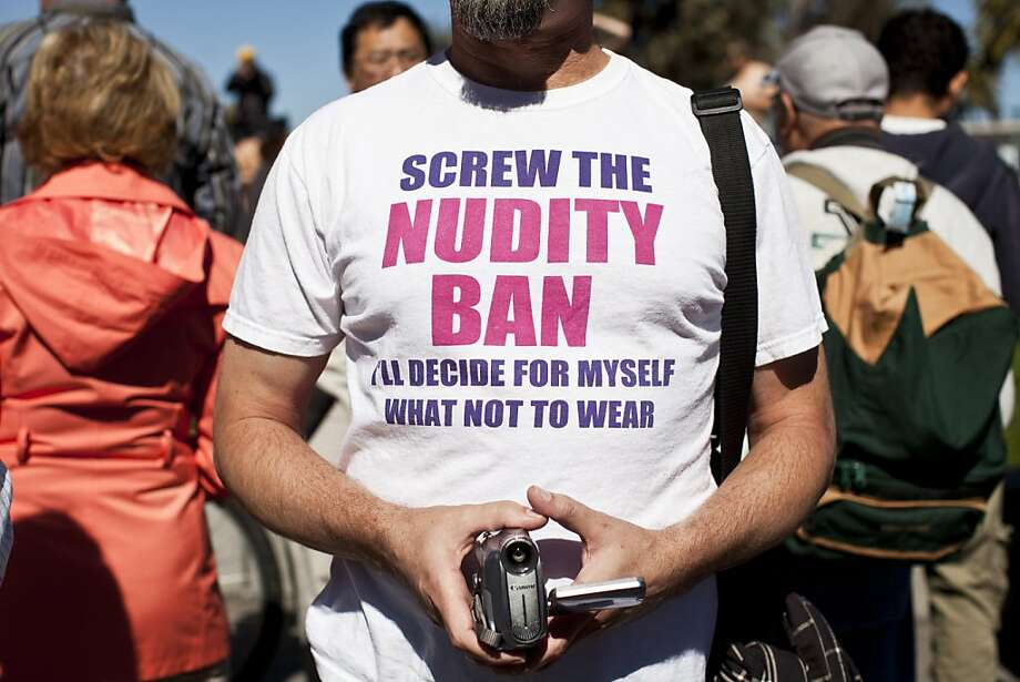 Mitch Hightower, webmaster for bucknakedinpublic.com, wore a shirt in defiance of the nudity ban before the World Naked Bike Ride at Justin Herman Plaza in San Francisco, Calif., Saturday, March 9, 2013. Photo: Jason Henry, Special To The Chronicle