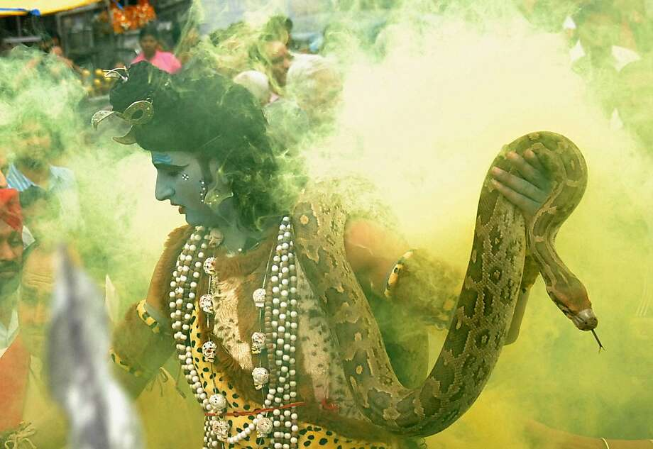 Eve of destruction:A Hindu dressed as Lord Shiva holds an ajgar (a snake that appears to be a python) as he takes part in a religious procession on the eve of the Maha Shivratri festival in Jalandhar, India. Hindus mark Maha Shivratri by offering special prayers and fasting to worship Lord Shiva, the lord of destruction. Photo: Sahmmi Mehra, AFP/Getty Images