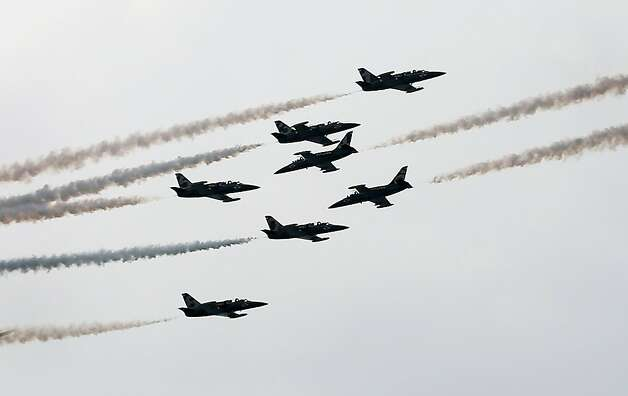 French Breitling Jet Team comprising of 7 Aero L-39 Albatross planes perform stunts during their Southeast Asian Tour aerobatics showcase on Saturday March 9, 2013 in Singapore. This is the first stop of their tour and the team will be showcasing their aerobatics performances in other countries such as the Philippines, Indonesia, Malaysia and Thailand.(AP Photo/Wong Maye-E) Photo: Wong Maye-E, Associated Press