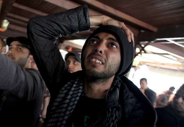 An Egyptian man reacts as he watches a televised court verdict confirming death sentences against 21 people for their role in a deadly 2012 soccer riot, in a coffee shop in Port Said, Egypt, Saturday, March 9, 2013. (AP Photo/Khalil Hamra) Photo: Khalil Hamra, Associated Press