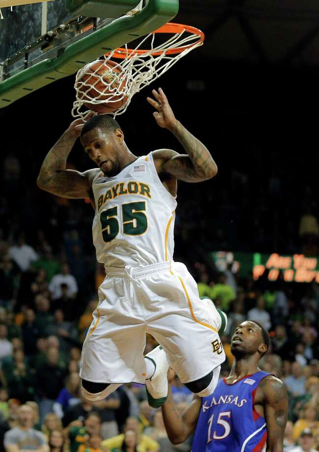 Baylor's Pierre Jackson (55), left, scores over Kansas Elijah Johnson (15), right, in the second half of a NCAA basketball game, Saturday,  March 9,  2013, in Waco, Texas. Baylor won 81-58.(AP Photo/Waco Tribune Herald, Rod Aydelotte) Photo: Rod Aydelotte