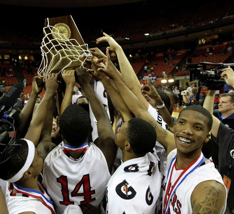Terry teammates celebrate with the trophy after their win over Dallas Kimball in the Class 4A championship game Saturday. Photo: Karen Warren, Staff / © 2013 Houston Chronicle