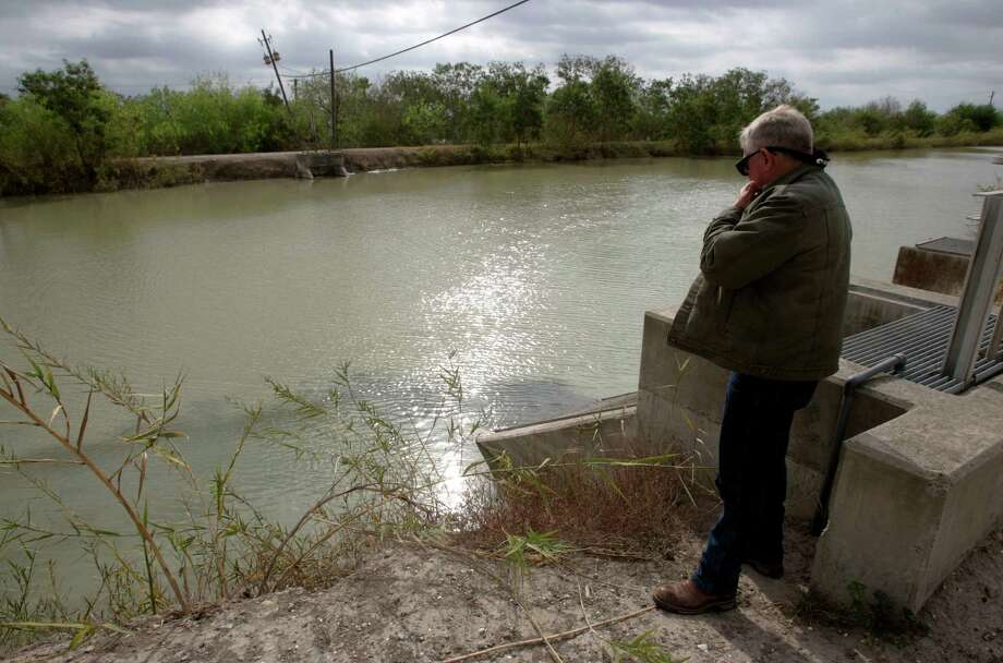JoJo White, general manager with Hidalgo Cameron Counties Irrigation District #9, stands at the main canal in  Mercedes in March.  The canal draws water from the Rio Grande and flows to four cities. Over 200,000 people in Irrigation District #9 depend on this water. Photo by Delcia Lopez Photo: Delcia Lopez