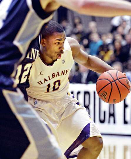 UAlbany's #10 Mike Black drives under a Maine defender during their America East tournament game in