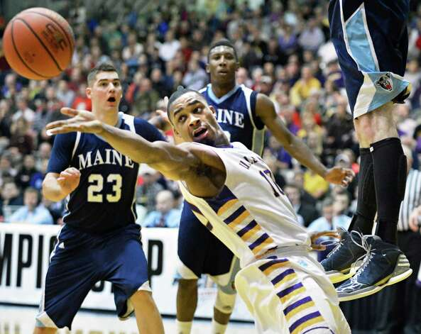 UAlbany's #10 Mike Black surprises Maine defenders with a trick pass during their America East tournament game in Albany Saturday March 9, 2013.  (John Carl D'Annibale / Times Union) Photo: John Carl D'Annibale / 10021441A