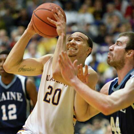 UAlbany's #20 Gary Johnson shoots as Maine's #44 Mike Allison defends during their America East tournament game in Albany Saturday March 9, 2013.  (John Carl D'Annibale / Times Union) Photo: John Carl D'Annibale / 10021441A