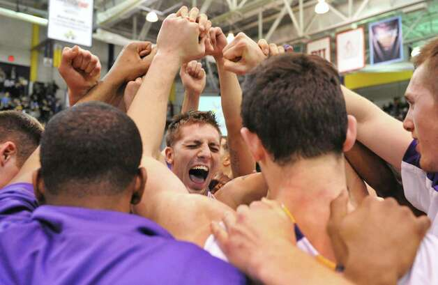 UAlbany's Blake Metcalf, center, and teammates celebrate their win over Maine in an America East tournament game in Albany Saturday March 9, 2013.  (John Carl D'Annibale / Times Union) Photo: John Carl D'Annibale / 10021441A