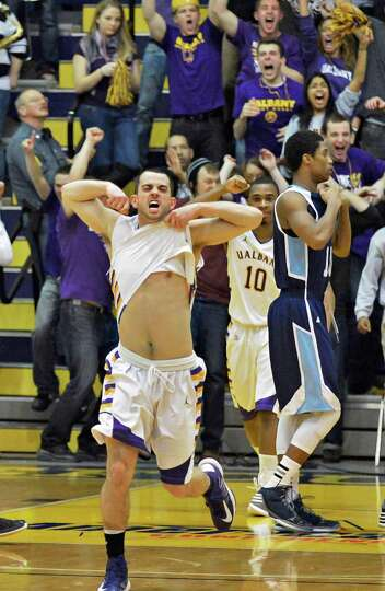 UAlbany's Jacob Iati celebrates their win over Maine in their America East tournament game in Albany
