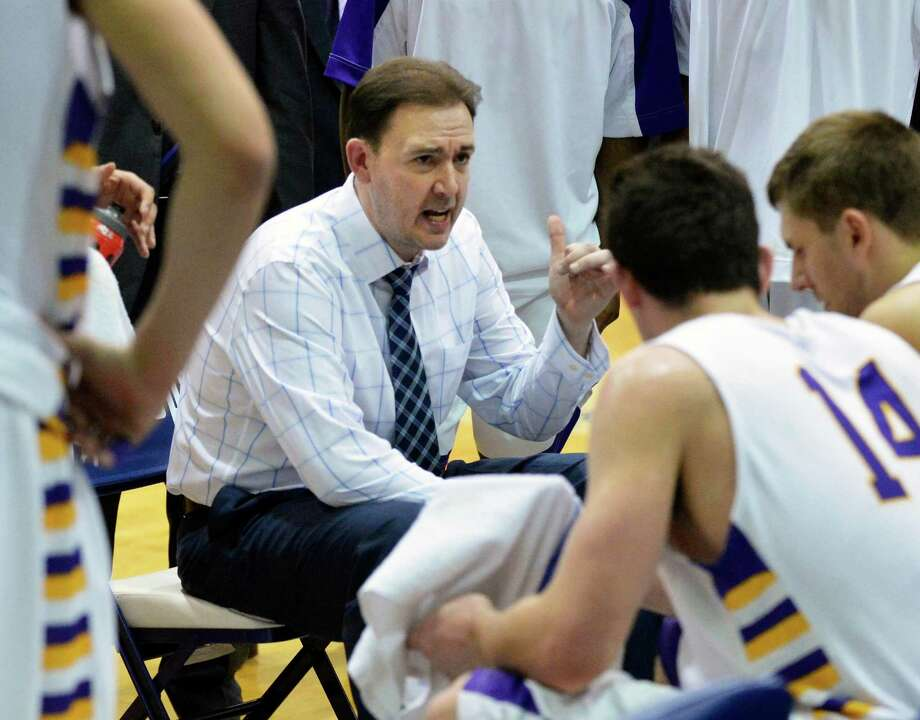 UAlbany head coach Will Brown with players during a time out in their America East tournament game against Maine in Albany Saturday March 9, 2013.  (John Carl D'Annibale / Times Union) Photo: John Carl D'Annibale / 10021441A