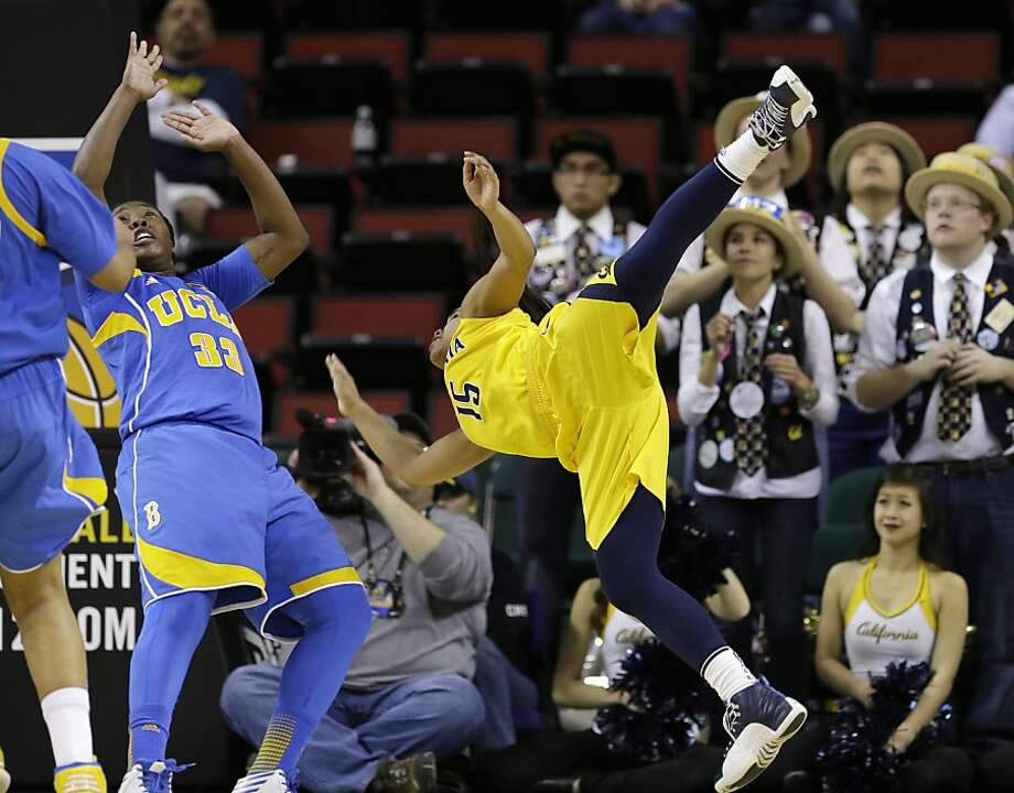 Cal point guard Brittany Boyd flips in front of the band after being fouled in the second half as UCLA's Jasmine Dixon watches the ball. Photo: Elaine Thompson, Associated Press