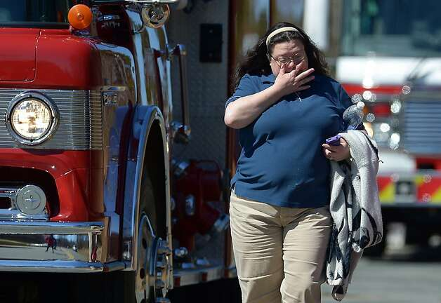 Kimberly Freeman cries at the scene of a house fire at 5913 NC 61 north in Gibsonville, N.C. on Saturday, March 9, 2013 where her 4-year-old grandson and a 1-year-old girl died. (AP Photo/Burlington Times News, Scott Muthersbaugh) Photo: Scott Muthersbaugh, Associated Press