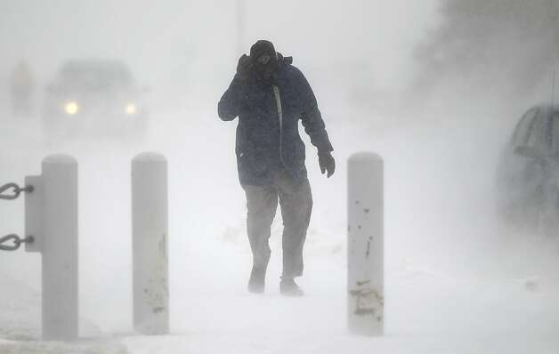 A man walk struggles to walk as blizzard conditions set in at the U.S. Air Force Academy, in southern Colorado on Saturday March 9, 2013. A strong winter storm brought messy weather to the center of the nation on Saturday. A low pressure system moved northeastward and off the Central Rockies, into the Plains by mid-day on Saturday. (AP Photo/Brennan Linsley) Photo: Brennan Linsley, Associated Press