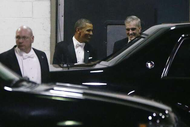 President Barack Obama walks with Chief of Staff Denis McDonough, right, as they leave the Gridiron Dinner through a loading area at a hotel in Washington, Saturday, March 9, 2013. (AP Photo/Charles Dharapak) Photo: Charles Dharapak, Associated Press