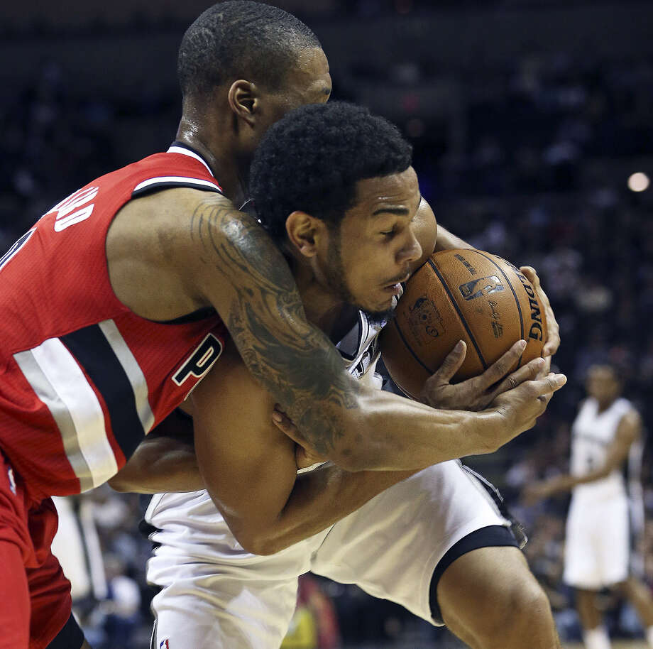Portland rookie point guard Damian Lillard tries to get the ball away from Spurs counterpart Cory Joseph during the Blazers' surprising 136-106 blowout of the Spurs on Friday night at the AT&T Center. Photo: Tom Reel / San Antonio Express-News
