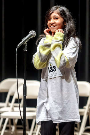Swati Sharma, 12, wins the Express-News' Regional Spelling Bee on Saturday at Trinity University's Laurie Auditorium. Photo: Marvin Pfeiffer/ San Antonio Express-News
