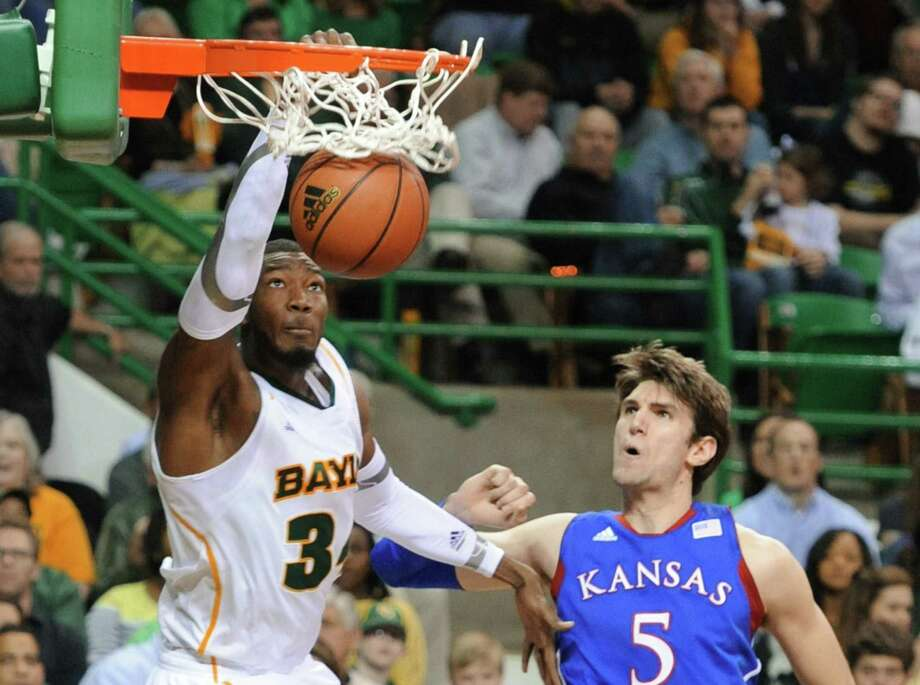 Baylor's Cory Jefferson, who hit the first three 3-pointers of his college career on Saturday, dunks for two of his 25 points after slipping past Kansas center Jeff Withey in the second half. Photo: Rod Aydelotte / Waco Tribune Herald
