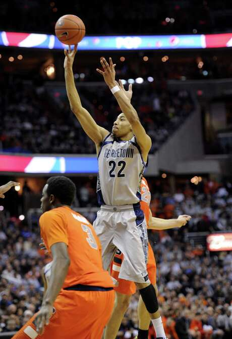 Georgetown forward Otto Porter Jr. takes a shot over Syracuse forward Jerami Grant in the second half. Photo: Nick Wass / Associated Press
