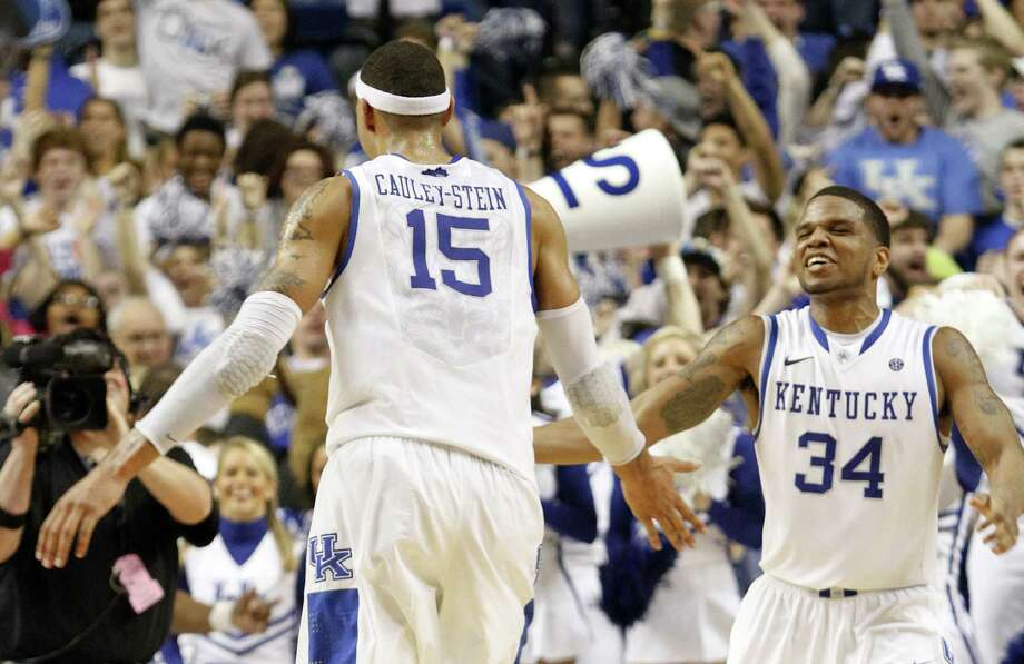 Kentucky's Willie Cauley-Stein (left) and Julius Mays celebrate after Kentucky upset No. 11 Florida, the Southeastern Conference's regular-season champion. Photo: James Crisp / Associated Press
