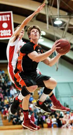 Chipper McClelland, Ridgefield high school, goes up for a shot in a quarterfinal round 2013 CIAC class LL boys basketball tournament game against Fairfield Prep held at Alumni Hall, Fairfield University, Fairfield CT on Saturday March 9th 2013. Photo: Mark Conrad / Connecticut Post Freelance
