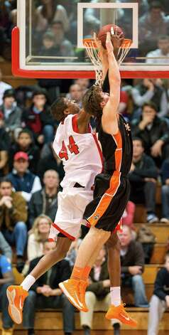 Paschal Chukwu, Fairfield Prep, blocks a shot by Ridgefield high school's Patrick Racy in a quarterfinal round 2013 CIAC class LL boys basketball tournament game held at Alumni Hall, Fairfield University, Fairfield CT on Saturday March 9th 2013. Photo: Mark Conrad / Connecticut Post Freelance