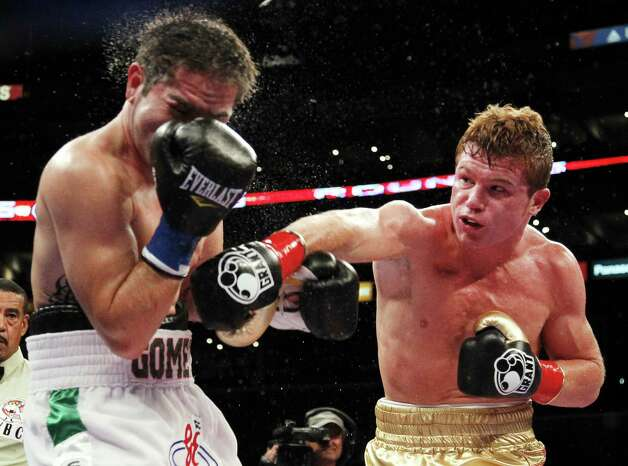 Canelo Alvarez (right), shown in his WBC super welterweight bout vs. Alfonso Gomez in 2011, will be in town Wednesday for a news conference. Photo: Danny Moloshok / Associated Press
