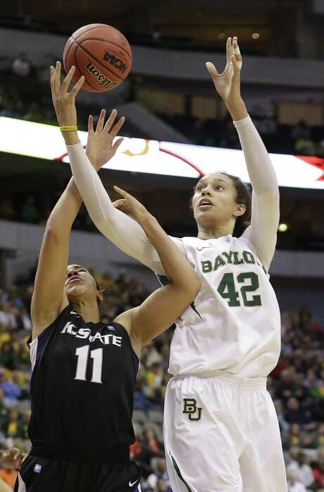 Kansas State's Chantay Caron (left) tries to keep Baylor's Brittney Griner from getting a rebound in the second half. Photo: LM Otero / Associated Press