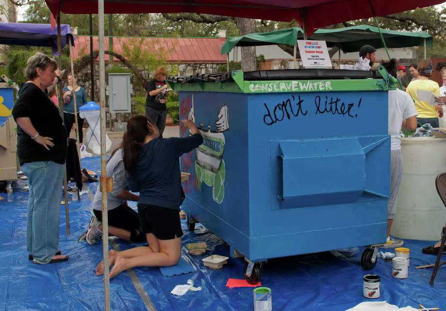 Members of the Communications Art High School paint a dumpster during   the S.M.A.R.T. (Supporting Multiple Arts Resources Together) third annual Pie to the People at the historic La Villita March 9, 2013. During the Student Dumpster Design Competition, teams are challenged with creating a water superhero tasked with keeping earthÕs natural resource, water, clean, pure and sustainable. Photo: Steve Faulisi, San Antonio Express-News / ©2013 San Antonio Express-News