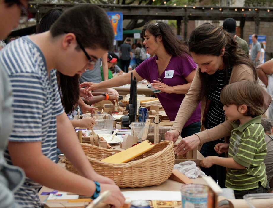 Old and young alike use wood and cardboard to build a sculpture at the Sculpture Zone table during the S.M.A.R.T. (Supporting Multiple Arts Resources Together) third annual Pie to the People at the historic La Villita March 9, 2013. Photo: Steve Faulisi, San Antonio Express-News / ©2013 San Antonio Express-News