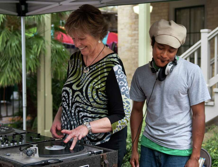 Allison Eustance (left) scratches and spins a record as DJ Rasta Mike of Lone Star Turn Table  moves with the beat during the S.M.A.R.T. (Supporting Multiple Arts Resources Together) third annual Pie to the People at the historic La Villita March 9, 2013. Photo: Steve Faulisi, San Antonio Express-News / ©2013 San Antonio Express-News